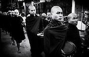 Monks receiving alms on the streets of Yangon (Rangoon) Myanmar (Burma) January 2012