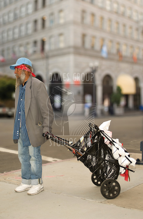 Homeless man dragging a cart in San Diego