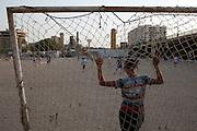 Iraqi boys play soccer in a dusty lot in Baghdad, Iraq August 26, 2010.   .