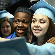 John Dickinson High School graduates Daniel White and Mailyn Klein take photos together prior to John Dickinson 55th commencement exercises Saturday, June 06, 2015, at The Bob Carpenter Sports Convocation Center in Newark, Delaware.