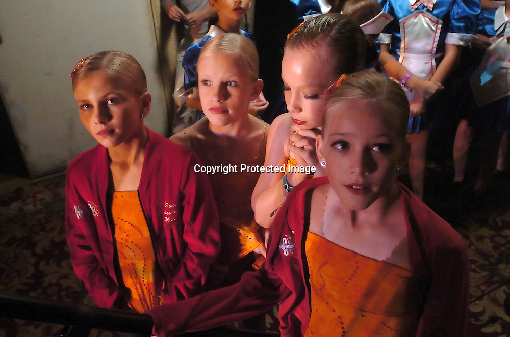 Whitney Schamnski(l), Crystal Barney(second from left), Skylar Olsen(second from right), and Addie Huntsaker(r), dancers from the Dance Club of Orem, Utah, wait to see it they won the New York Dance Alliance's National Mini Critics' Choice award at the New York Dance Alliance's national competition finale July 10, 2005 in New York City. <br /> Photo by Keith Bedford