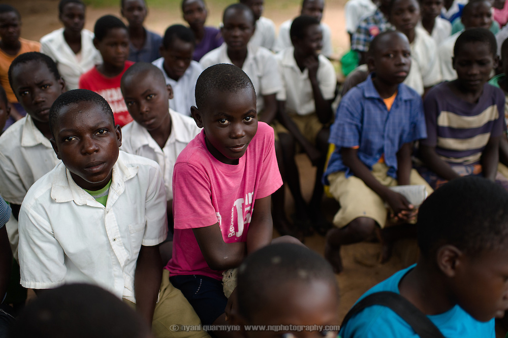 "Jacob Kisangala, wearing a Plan International ""Because I am a Girl"" T-shirt, during a talk on menstrual hygiene management at Achilet Primary School near Tororo in Eastern Uganda on 1 August 2014. Education about menstruation is provided to both boys and girls to destigmatise it, and to improve the general level of knowledge about it in the community."
