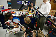 Malia Obama, daughter of Democratic presidential hopeful Senator Barack Obama, speaks to reporters as her mother Michelle Obama speaks to supporters during a rally in Concord, New Hampshire June, 2, 2007. .