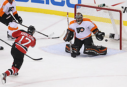 May 3, 2012; Newark, NJ, USA;  New Jersey Devils left wing Ilya Kovalchuk (17) scores a goal on Philadelphia Flyers goalie Ilya Bryzgalov (30) during the first period in game three of the 2012 Eastern Conference semifinals at the Prudential Center.