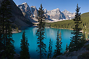 """A yellow canoe plies blue-green Moraine Lake in Valley of the Ten Peaks, Banff National Park, Alberta, Canada. Banff is part of the Canadian Rocky Mountain Parks World Heritage Site declared by UNESCO in 1984. Panorama stitched from 5 images. Published in """"Light Travel: Photography on the Go"""" book by Tom Dempsey 2009, 2010."""