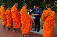 Monks collecting alms, Chiang Mai, Thailand