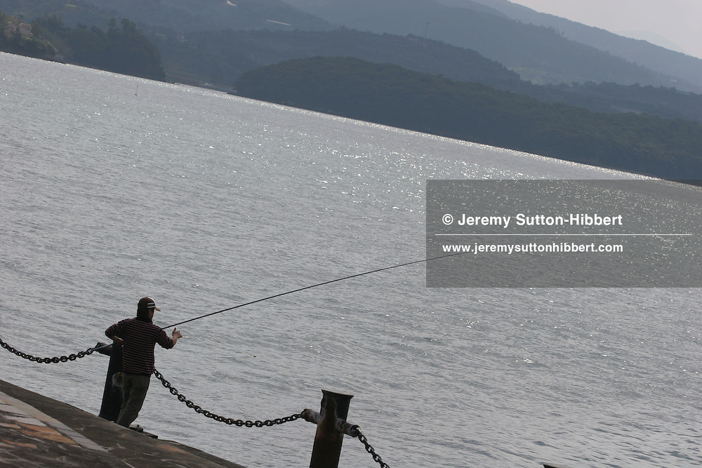 Fishing in Minamata Bay, once famous as the scene of the deadly Minamata disease poisoning, caused by the 1950's industrial release of methylmercury into Minamata bay, and the subsequent poisoning of residents who ate fish from the bay. Minamata.
