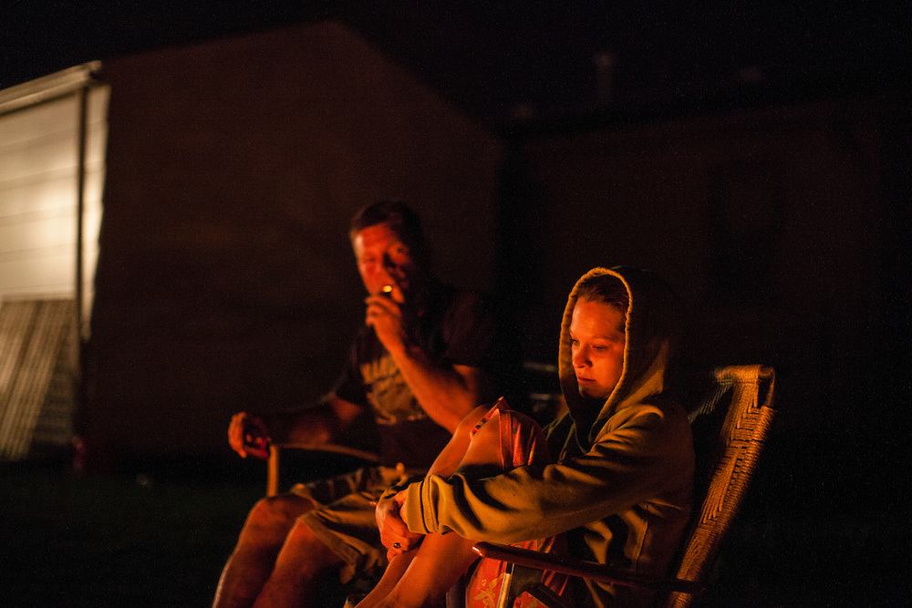 Steve McFarland and Penny Johnson watch a bonfire burn in their back yard on Sunday, March 25, 2012 in Webster City, IA.