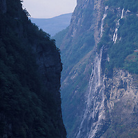 Europe, Norway. Waterfalls line the steep cliffs above the Geirangerfjord in western Norway
