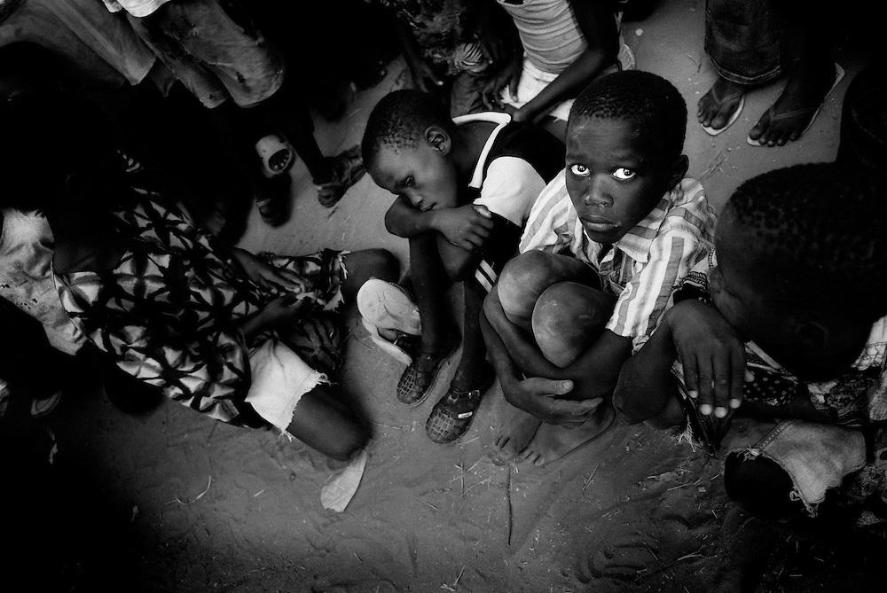 Kid waiting for food in Bissau, street scene
