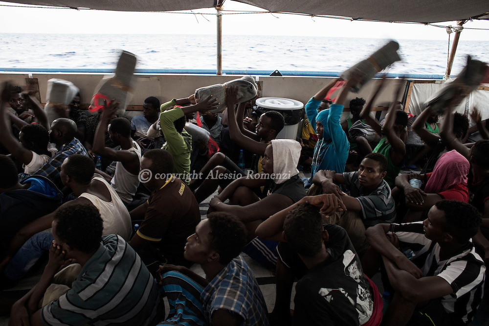 Italy: MSF Dignity1: Blankets are given to African migrants rescued at sea on the main deck of the Dignity1 on August 23, 2015. Alessio Romenzi
