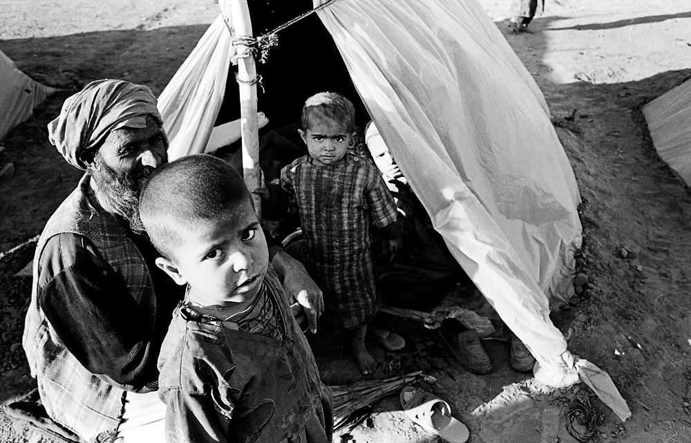 Having fled the conflict afflicting their homeland, Afghan refugees live under harsh conditions at Jallozai Refugee camp. Peshawer, Pakistan January 2002....
