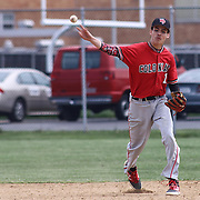William Penn Infielder Jacob Watson (11) throws the ball to first base during of a varsity scheduled game between the Colonials of William Penn and The St. Elizabeth Vikings Saturday, April 25, 2015, at William Penn High School baseball field in New Castle Delaware.<br /> <br /> William Penn defeats St. Elizabeth 6-5