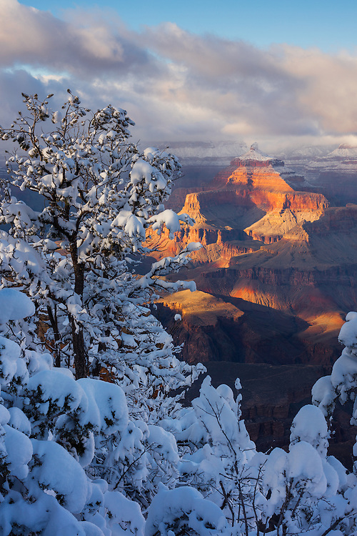 Isis Temple catches late afternoon light just on a winter day at the Grand Canyon. From Mather Point on the South Rim of Grand Canyon National Park in Arizona.