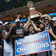 The Gonzaga men's basketball team hoists the WCC tournament trophy. (Austin Ilg photo, Gonzaga Bulletin)
