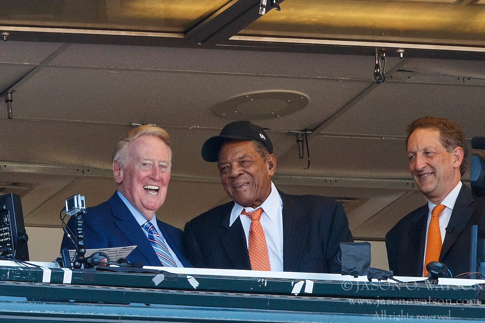 SAN FRANCISCO, CA - OCTOBER 02: Broadcaster Vin Scully (left) is congratulated on his final broadcast by hall of famer Willie Mays during the fourth inning between the San Francisco Giants and the Los Angeles Dodgers at AT&T Park on October 2, 2016 in San Francisco, California. The San Francisco Giants defeated the Los Angeles Dodgers 7-1. (Photo by Jason O. Watson/Getty Images) *** Local Caption *** Vin Scully; Willie Mays