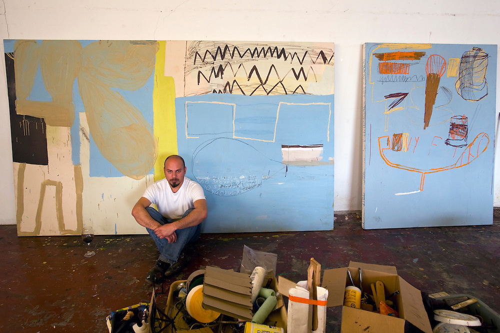 Tijuana Mexico ..abstract painter Enrique Ciapara at his studio..While working on this long term project 'La Frontera' I want to examine the cultural and humanitarian activities on both sides of a border that keeps the United States and Mexico apart with a wall of steel already 600 miles long. The turf wars of drug cartels, arms trafficking and rampant kidnappings turned cities like Tijuana into some of the most dangerous places on earth. Despite the violence many brave artists, photographers, architects, poets, humanitarians, teachers etc live and work in the shadow of the wall on both sides and have a positive influence on this region; they are the focus of my long term project along the border. (Over time I plan to cover the entire length from the Atlantic to the Pacific, these images were taken in and around Tijuana).© Stefan Falke