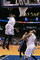Mar 25, 2013; Orlando, FL, USA; Miami Heat small forward LeBron James (6) dunks the ball over Orlando Magic small forward Tobias Harris (12) during the third quarter at Amway Center. Miami defeated Orlando 108-94.