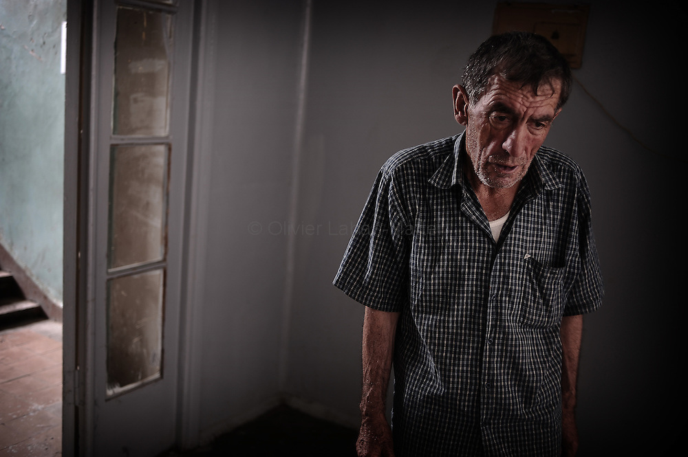 A Georgian man who fled his village after a Russian attack stands in a hallway in the former Russian Ministry of Justice on August 29, 2008 in Tbilisi. Russia is facing an avalanche of criticism from the West over its decision to recognise the independence of two Georgian secessionist regions at the heart of the conflict: South Ossetia and Abkhazia.