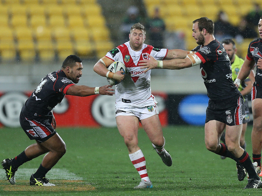 Trent Merrin of the Dragons is challenged by by Siliva Havili, left, and Captain Simon Mannering of the New Zealand Warriors during their round 22 NRL match at Westpac  Stadium, Wellington on  Saturday, August 08, 2015. Credit: SNPA / David Rowland