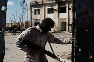 Libya, Zliten: A Misurata army soldier open the gate of the police base where a terror attack left 62 dead and almost 150 wounded. <br />