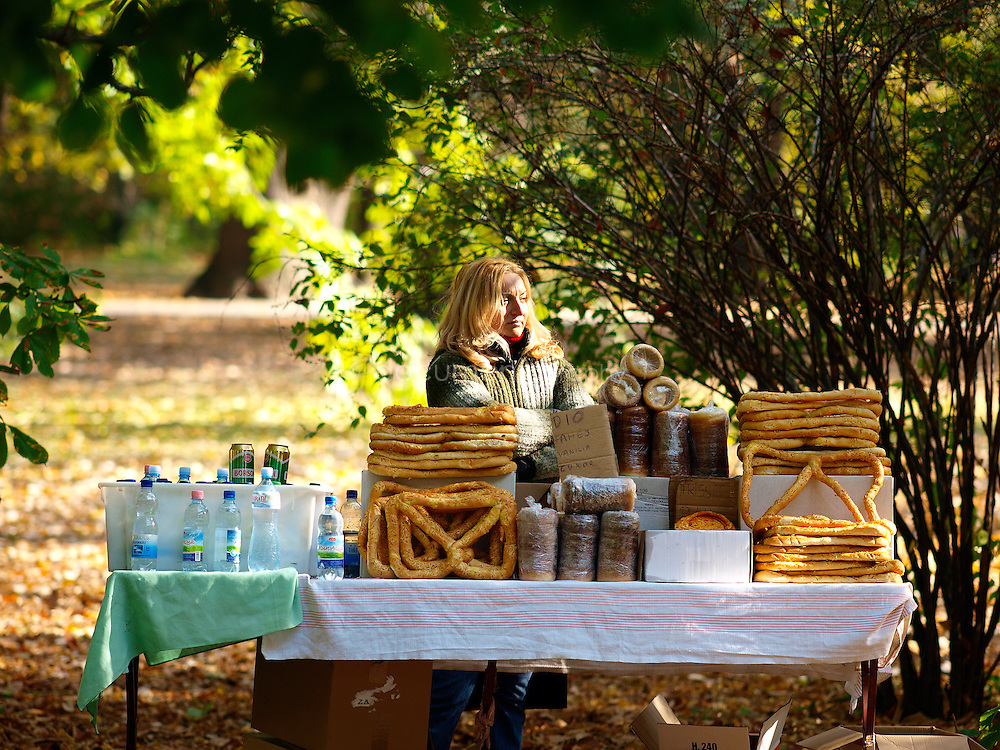 A woman selling bread in Margaret Island park, Budapest, Hungary.
