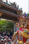 Giant God during the Bao Sheng Festival. On the 14th day of the 3rd lunar month in the Chinese calendar, the birthday of the Bao Sheng Emperor is celebrated at Taipeis Bao-an Temple, in a riot of color, firecrackers, ritual and sound. The Bao-an temple itself was constructed in 1805