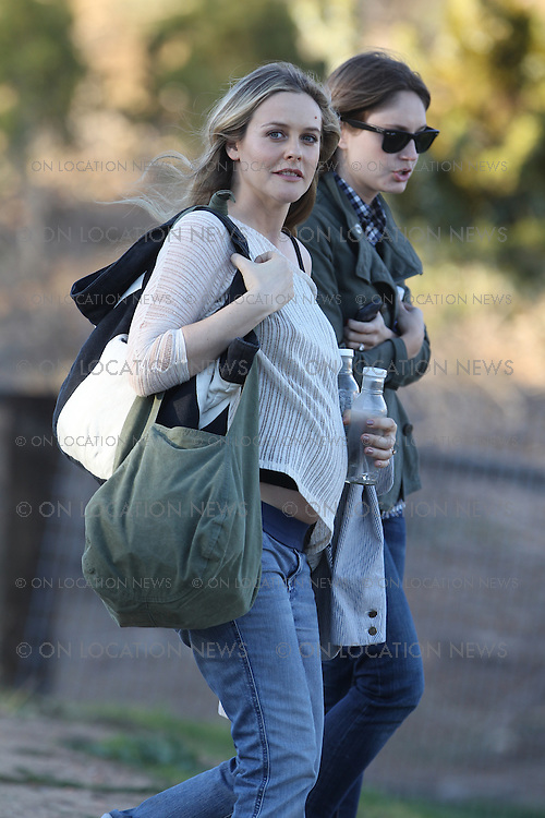 "January 26th, 2011  Acton, CA. ***EXCLUSIVE*** A very pregnant Alicia Silverstone does a Vogue Magazine photo shoot at ""Animal Acres"" animal sanctuary outside of LA. for which she has been a big supporter of. Alicia spent the day at the shoot laying on a pig, hanging out with some cows, and sitting in a barn with a bunch of turkeys, chickens and ducks. Alicia's Motor Home for the shoot was run on bio diesel fuel. Silverstone was seen snacking on grapes and other healthy items through out the shoot. When the shoot was over, Alicia left for home in her comfortable looking street clothes and flashed a smile as well as a closer look at her baby bump. Photo by Eric Ford 1/818-613-3955  info@onlocationnews.com"