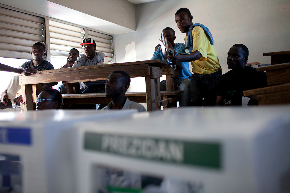 Monitors watch activity in a polling station during presidential and legislative elections on November 28, 2010 in Port-au-Prince, Haiti.