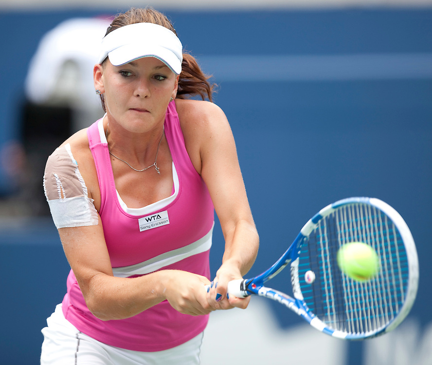 Agnieszka Radwanska returns a ball during her semi-final match against Samantha Strosur at the Rogers Cup WTA event in Toronto, Ontario, August 14, 2011. Strosur defeated Radwanska in 3 sets.<br /> AFP PHOTO/Geoff Robins