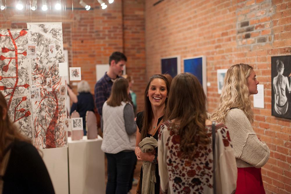 Community members enjoy Gonzaga artwork at the Senior Art Show at Richmond Art Collective on Friday, April 8th, 2017.