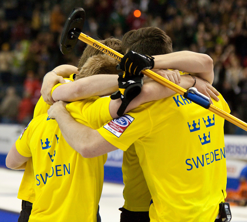 Sweden celebrates their  7-6 win over Norway in the bronze medal match at the Ford World Men's Curling Championships in Regina, Saskatchewan, April 10, 2011.<br /> AFP PHOTO/Geoff Robins