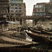 """The Buriganga river is now one of the most polluted rivers in Bangladesh due to dumping of industrial and human waste. A World Bank study said four major rivers near Dhaka -- the Buriganga, Shitalakhya, Turag and Balu -- receive 1.5 million cubic metres of waste water every day from 7,000 industrial units in surrounding areas and another 0.5 million cubic meters from other sources. """"The pollutants have eaten up all oxygen in the Buriganga and we call it biologically dead. It is like a septic tank,"""" said Khawaja Minnatullah, a World Bank specialist on environment and water management.""""There is no fish or aquatic life in this river apart from zero oxygen survival kind of organisms."""" Chemicals such as cadmium and chromium, and other elements such as mercury carried by the industrial waste are also creeping into the ground water, posing a serious threat to public health."""