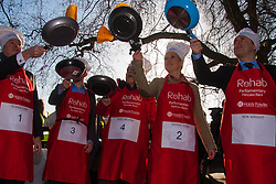 London, February 17th 2015. Members of Parliament put their dignity aside for a bit of fun as they compete in the annual Parliamentary Pancake Race in Victoria Tower Gardens adjacent to the House of Lords.  PICTURED: The media team practice tossing their pancakes prior to the start. Left to right, Robbie Gibb of Sunday Politics, the Sunday People's Political Editor Nigel Nelson, Nigel Nelson, Sky News Political Correspondent Sophie Ridge, and BBC Political Correspondent Ben Wright.