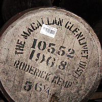 Europe, United Kingdom, Great Britain, Scotland. Macallan Glenlivet whiskey cask in a distillery warehouse.