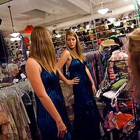 YBOR CITY, FL -- March 6, 2010 -- Sara Barbee, 16, of Lakeland, Fla., tries on a dress as she shops with her mother, Debbie, at right, for her prom dress at La France in Ybor City near Tampa, Fla., on Saturday, March 6, 2010.  Tampa and the surrounding area has become a hub for vintage clothing, furniture, and trinkets.