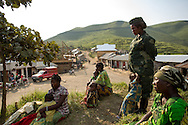 "First Sergeant Zawadi Bati, 27, a member of the Democratic Republic of Congo's army, the FARDC, stands guard with her two-year-old daughter Dorcas, who follows her to her posts, in the village of Mushake in North Kivu, Democratic Republic of Congo, July 31, 2014. Zawadi is seven months pregnant with her second child.  She gave birth to her after marching with her unit for several days to a village called Kigulube.  Within three of the birth the unit moved again, along with Zawadi and baby Dorcas.  ""As I was walking I didn't feel it, I had my mind set up like a soldier, I was just walking with my gun."" Zawadi says that the father of her second baby died six months ago after being struck by lightening.  He was also a soldier."