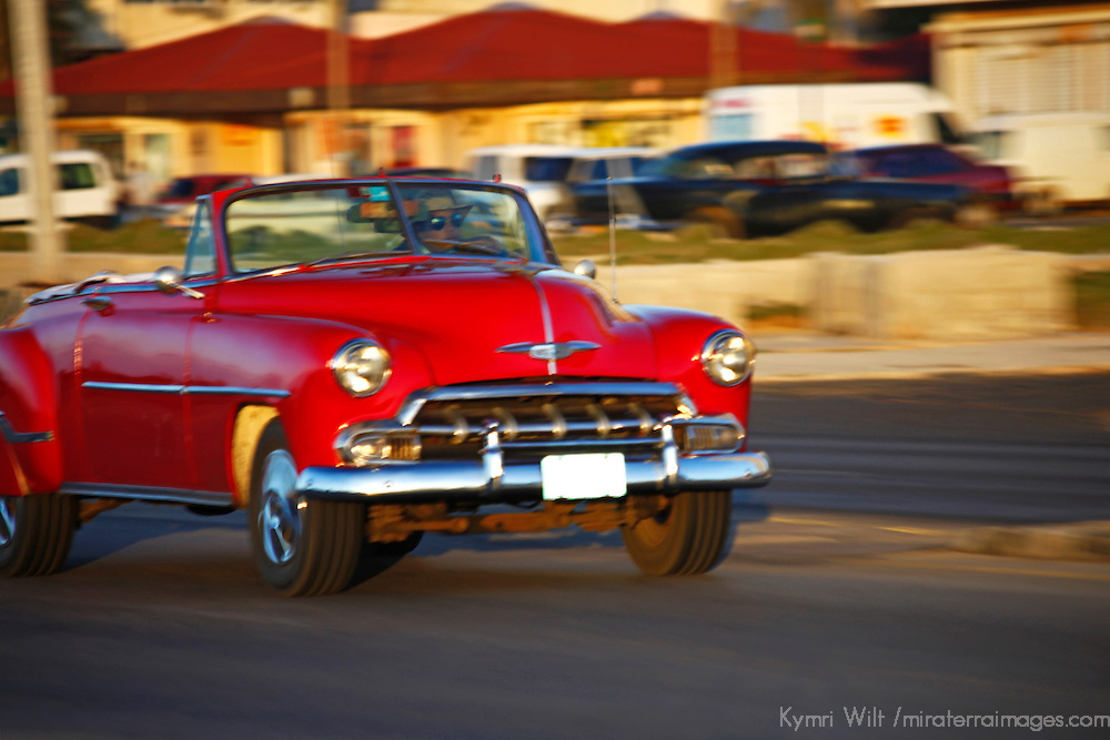 Central America, Cuba, Havana. Classic Car driving on the Malecon.