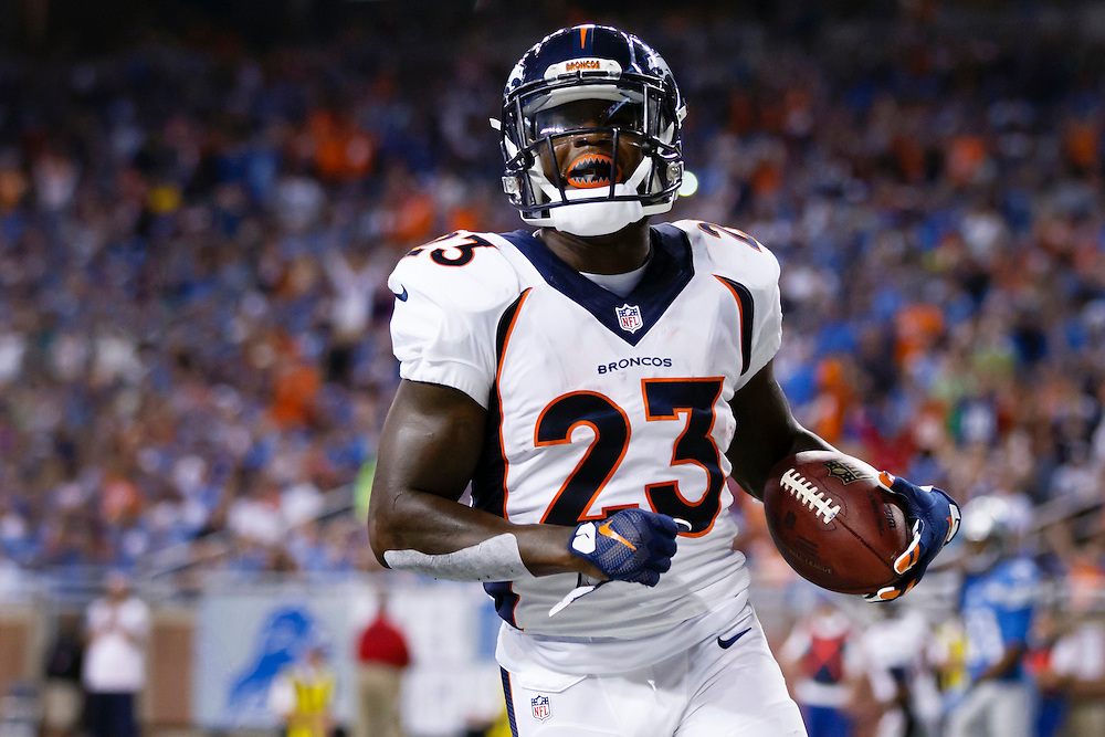 Denver Broncos running back Ronnie Hillman (23) rushes for a touchdown against the Detroit Lions during an NFL football game at Ford Field in Detroit, Sunday, Sept. 27, 2015. (AP Photo/Rick Osentoski)