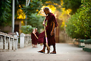 A novice keeping the temple grounds clean near Yangon, Myanmar.