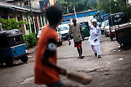 Children play cricket in Colombo, Sri Lanka, July 4, 2009. With the end of the 26 war between the Sri Lankan government and the LTTE, security in the capital city remains on high alert.