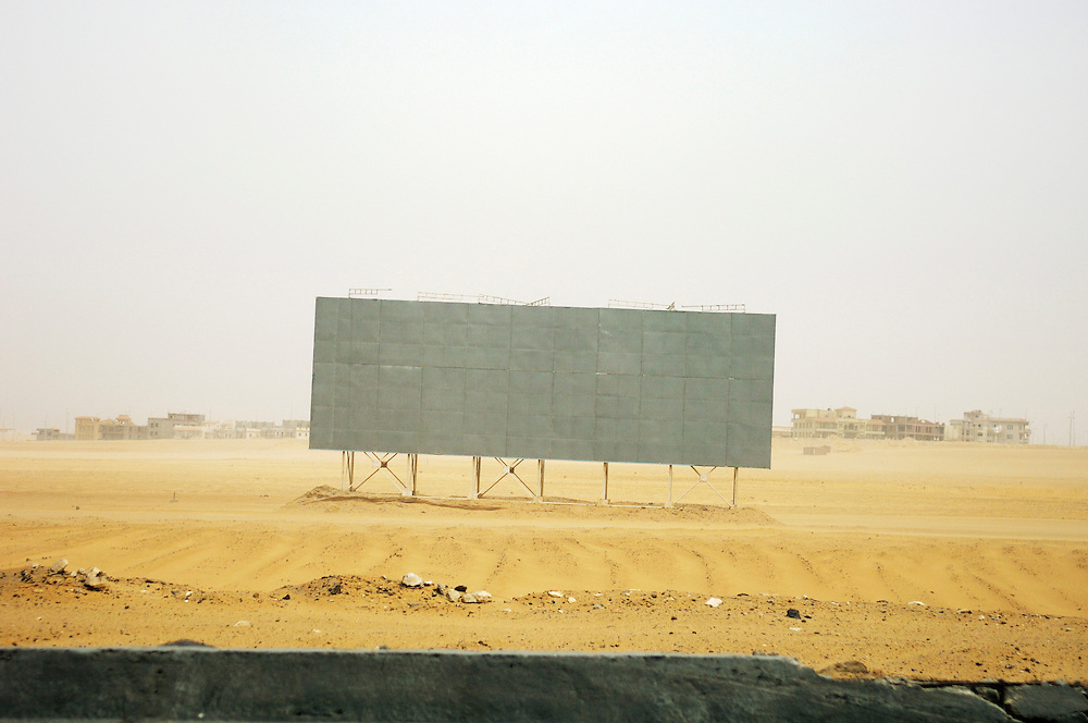 A blank advertising hoarding put up in the desert, which developers hope to turn into a new city suburb for affluent Egypians and foreigners who are increasingly moving into gated communities.
