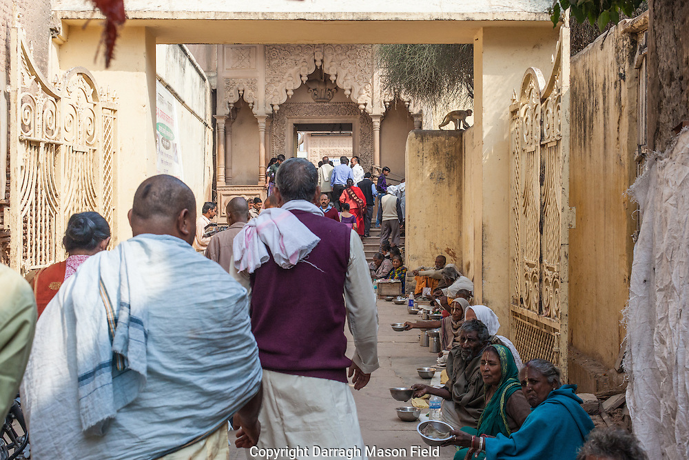 Beggars and Widows compete for the alms of pilgrims to the famous temple in Vrindavan where Krishna is pre ported to manifest each night and dance through the temple gardens.