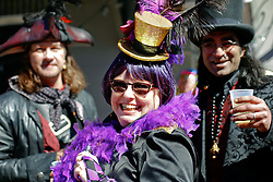 09 February 2016. New Orleans, Louisiana.<br /> Mardi Gras Day. Revelers in bright and colourful costumes fill the French Quarter. <br /> Photo&copy;; Charlie Varley/varleypix.com