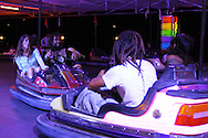 Rainbow family members playing in the fair bumping cars. The Rainbow family was invited to participate in the annual summer festivity of the village of Salto.  European Rainbow Gathering of 2011 in Portugal
