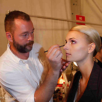 Backstage at Michael Kors - makeup artist Dick Page working during Mercede's Benz Fashion Week Spring 2010 on September 13, 2009. ..