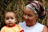 Grandmother with granddaughter on a farm in Vega Yumuri, near La Maquina, Guantanamo Province, Cuba.