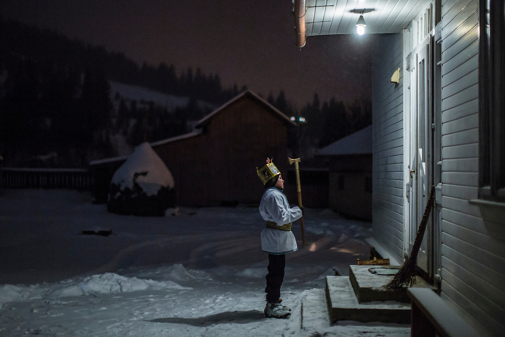 ILTSI, UKRAINE - JANUARY 6: Sviatoslav Mahulia, 12, sings in front of a house while going door to door caroling in celebration of Orthodox Christmas on January 6, 2015 in Iltsi, Ukraine. While many of the traditions are similar across Ukraine, the songs and clothing of the Hutsul culture are common in the Carpathian Mountains. (Photo by Brendan Hoffman/Getty Images) *** Local Caption *** Sviatoslav Mahulia