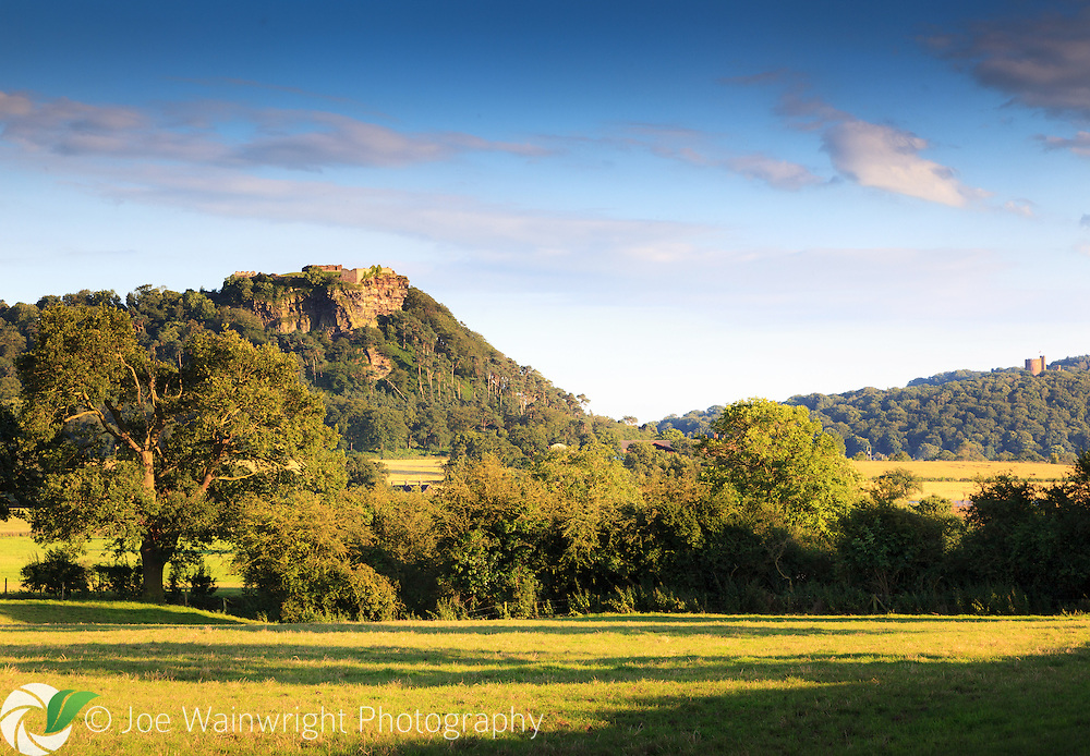 Beeston and Peckforton Castles, Cheshire, captured on a sunny July evening.  Medieval Beeston Castle (left) is open to the public and managed by English Heritage.  Peckforton Castle was built in the 19th century and is now a hotel.